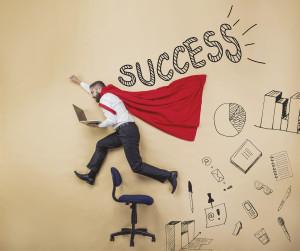 successful employee wearing superhero cape