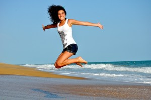 healthy woman jumping happily
