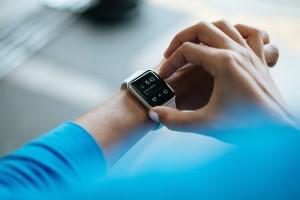 Person adjusting smartwatch