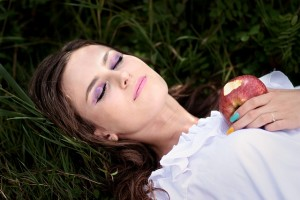woman sleeping and holding an apple