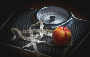 scale with tape measure and apple on top